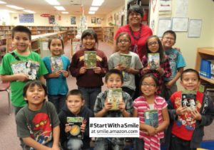 Smiling Navajo second graders who are learning to read donated Magic Tree House books.